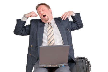 Yawning and bored businessman in office or traveling with laptop and luggage, isolated over white.