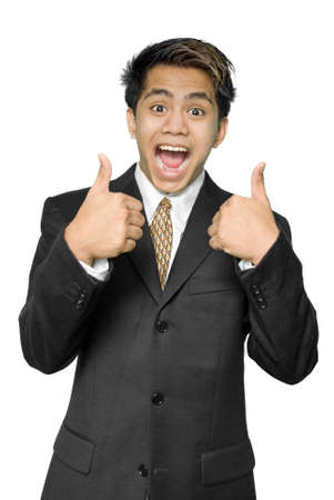 Young dynamic Indian businessman, yuppie type, intensely smiling, cheering and making the thumbs up gesture. Isolated over white.