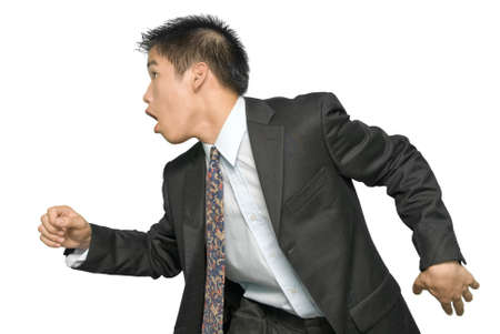 Rushing and running young Asian businessman or salesman in profile, upper body. Isolated over white. photo
