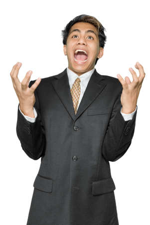 Young Indian stressed businessman, yuppie type, standing with a terrified expression or dramatic grimace on his face and grasping in the air with a desperate gesture of disbelief. Isolated over white. Stock Photo - 4083834