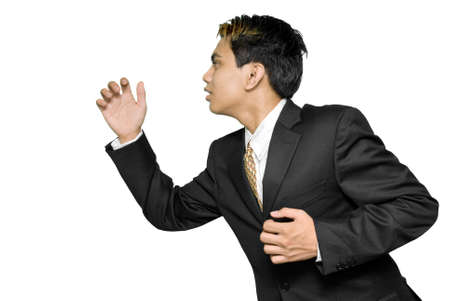 Rushing and running young Indian businessman or salesman in profile, upper body. Isolated over white. photo