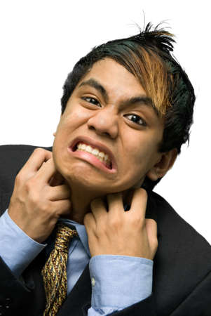 strangling: Portrait of young Indian businessman in suit grasping his collar in despair, screaming with an intense emotional facial expression like strangling himself. Isolated over white. Stock Photo