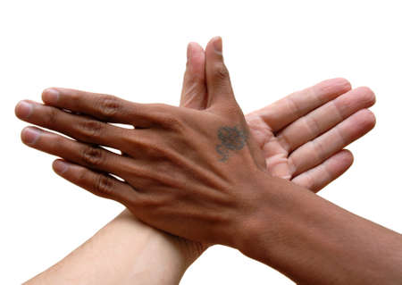 African black and Caucasian white hand touching thumbs up in unity. Isolated over white. Stock Photo