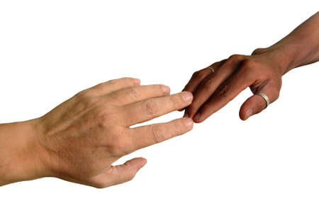 bigotry: African black and Caucasian white hand touching fingers in unity. Isolated over white.