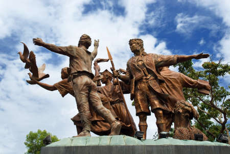 The Mindanao peace monument with angel and dove, a priest, a lumad (indigenous people) and a moro (Muslim) symbolizing the three ethnic and religious pillars of multicultural Mindanao in Davao City, Philippines.