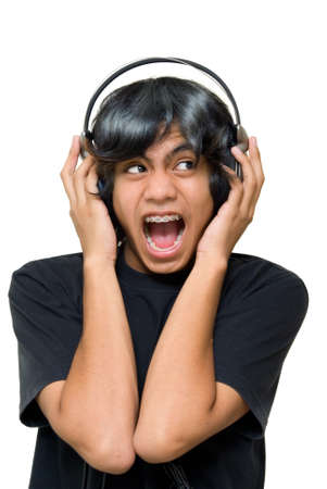 elated: Indian or Asian male teenager with headset going wild, yelling and cheering ecstatically listening to music. Isolated over white.