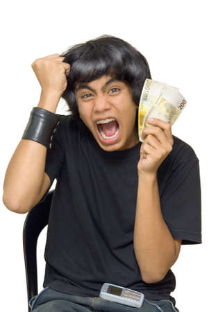 Indian or Asian male teenager going wild and yelling and cheering ecstatically with a fistful of Euro bills. Isolated over white. photo