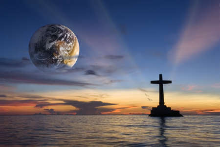 a courtesy: Colorful tropical marine sunset with a large concrete cross silhouette and a globe over Sunken Cemetery memorial, Camiguin, Philippines. Globe courtesy NASA.