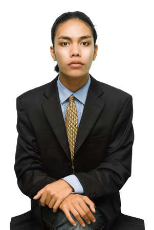 Young alternative mixed race businessman in a sitting pose as if waiting for an appointment or an interview. Isolated over white. photo
