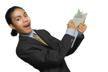Young alternative mixed race businessman leaning back and making notes on a clipboard with an excited expression on his face. Isolated over white. photo