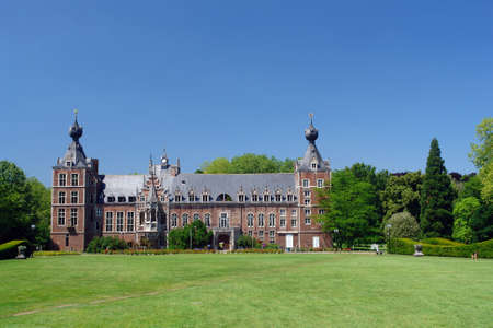 Frontal view of the facade of the Chateau Arenbergh, in Leuven, Flanders, Belgium, a vintage Renaissance and Neogothic castle in the Arenbergh Park. Currently a campus building. Banco de Imagens