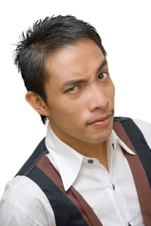 skeptic: Close-up portrait of a skeptic doubting Asian waiter with eyebrows raised and an inquisitive facial expression. Stock Photo