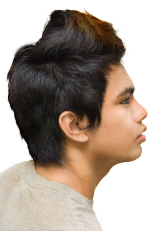 Profile or side portrait of seriously looking punk or emo Indian Asian teenager with dyed hair and crest. Isolated over white. photo