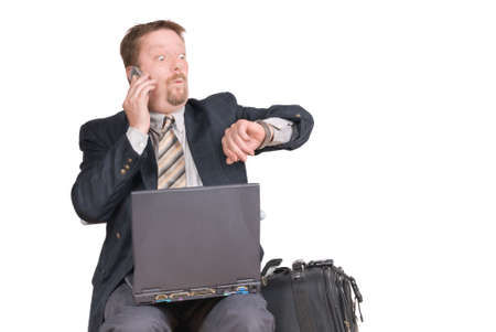 Calling travelling businessman or salesman with laptop and luggage checks his watch afraid being too late for an appointment or a flight, with a surprised facial expression. Isolated over white with copy space.