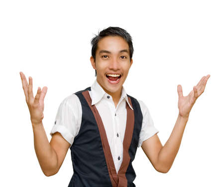 Young Asian cheering entrepreneur or salesman making a marketing presentation with arms wide open and raised in a convincing welcoming gesture. Isolated over white with copy space. Stock Photo