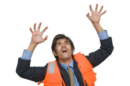 imminent: Young desperate Asian executive or corporate businessman in suit, necktie and life vest grasping upwards in the air with a horrified facial expression, attempting to escape imminent danger. Isolated over white.