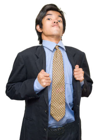 boastful: Young bossy bragging Asian executive or corporate businessman in suit and necktie standing with a boastful arrogant facial expression. Isolated over white. Stock Photo