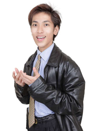 convincing: Oriental young classy smooth businessman in leather jacket with convincing hand gesture as if making business proposal. Isolated over white.