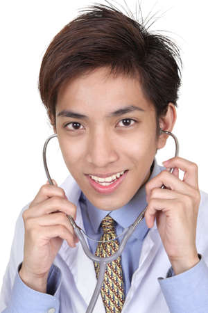 Close up portrait of young Chinese doctor with stethoscope and with a happy smiling and reassuring professional facial expression. Isolated over white. photo