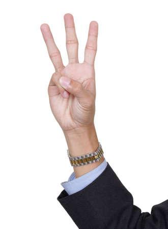 3 本の指指して、数 3、前方、やしを数える親指折り返されている, ビジネス スーツの腕を持つ。コピー領域を白で隔離されました。 写真素材