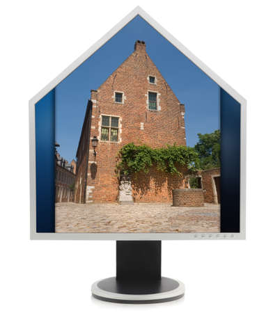 prestigious: Computer PC LCD screen monitor in the shape of a house with roof, containing an old prestigious and renovated medial house as for Internet real estate sales. Isolated over white.