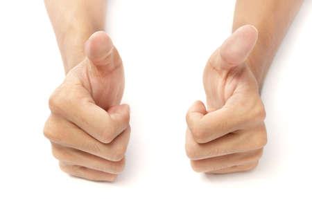 gestos: Dos manos masculinas sobre fondo blanco de escritorio con pulgares arriba. Concepto de �xito y aliento. Aislados sobre blanco excepto espect�culos naturales en la parte inferior.  Foto de archivo