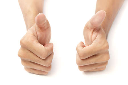 gestures: Two male hands on white desktop background with thumbs up. Concept of success and encouragement. Isolated over white except natural shows at bottom. Stock Photo