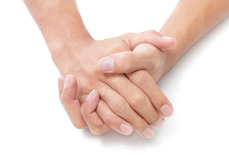 receptive: Two male hands folded on white desktop background expressing relaxation, contentment and listening attitude. Isolated over white except natural shows at bottom.