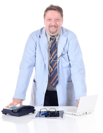 Mature doctor or physician standing at his desk in the office and smiling in a confident and friendly way. Isolated over white background. Zdjęcie Seryjne
