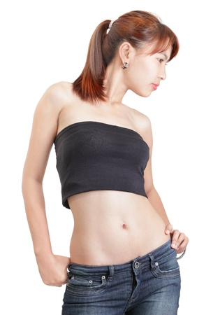 Profile 3/4 body view of an attractive young Chinese or Japanese woman with goth colored hairstyle hanging in ponytail standing and looking down dreamily, relaxed and graceful. Isolated over white.
