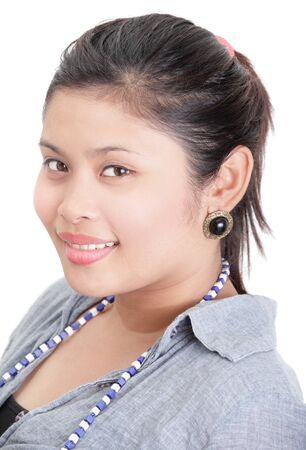 Closeup portrait of plump, obese and friendly smiling Indian-looking Asian girl. Isolated over white. Zdjęcie Seryjne