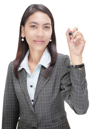 Standing young Asian businesswoman pointing with marker in front as if writing on a virtual chart. You can overlay your own transparent chart with a graph or text starting at the marker point. Focus on eyes, marker tip slightly OOF. Isolated over white.