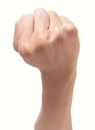 Strong clenched male fist held up, isolated over white. Zdjęcie Seryjne