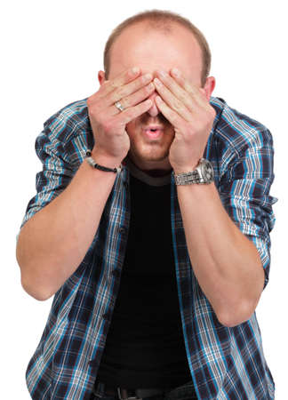 Portrait of a young Caucasian balding man covering eyes in denial and shocked as if ignoring reality. Isolated over white.
