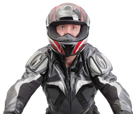 Macho tough motorcycle or bike rider in frontal view steering a bike (invisible) in full leather gear with helmet. Perfectly isolated over white so custom backdrops are easy to fit behind.
