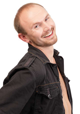 Young balding and bearded macho portrait, happily smiling in urban outfit, jeans jacket partly open. Isolated over white. Zdjęcie Seryjne