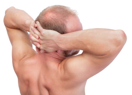 Back portrait shoulders-up of an undressed strong and muscular balding Caucasian man photo
