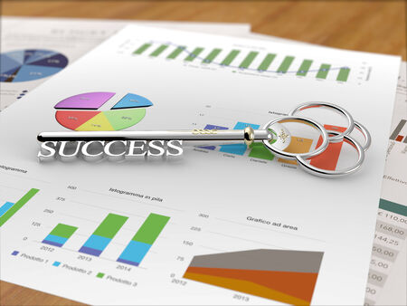 A silver key with the word success on a financial report photo