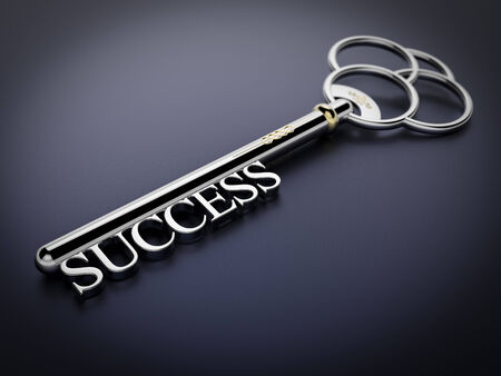 A silver key with the word Success on dark blue surface photo