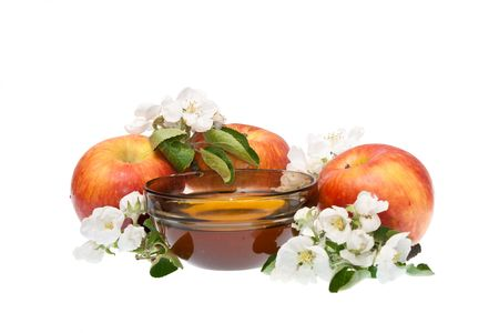 Apples and honey against white background