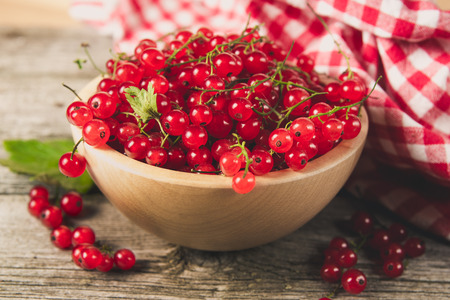 Red currant in the wooden bowl