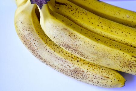 """A banana is an elongated, edible fruit – botanically a berry – produced by several kinds of large herbaceous flowering plants in the genus Musa. In some countries, bananas used for cooking may be called """"plantains"""", distinguishing them from dessert bananas. The fruit is variable in size, color, and firmness, but is usually elongated and curved, with soft flesh rich in starch covered with a rind, which may be green, yellow, red, purple, or brown when ripe. The fruits grow in clusters hanging from the.."""