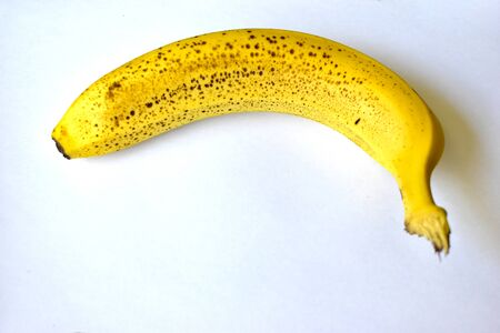 """A banana is an elongated, edible fruit – botanically a berry – produced by several kinds of large herbaceous flowering plants in the genus Musa. In some countries, bananas used for cooking may be called """"plantains"""", distinguishing them from dessert bananas. The fruit is variable in size, color, and firmness, but is usually elongated and curved, with soft flesh rich in starch covered with a rind, which may be green, yellow, red, purple, or brown when ripe. The fruits grow in clusters hanging from the.. 版權商用圖片"""