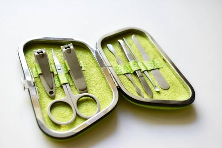 Green handbag with a set for a pedicure