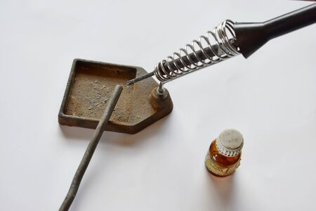 Soldering station and solder on a white background