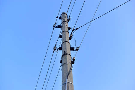 Concrete pole power lines with wires in the village
