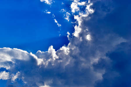 Evening sky with Cumulus clouds and sunset sun