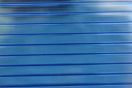 Blue plastic striped polycarbonate surface in the sun