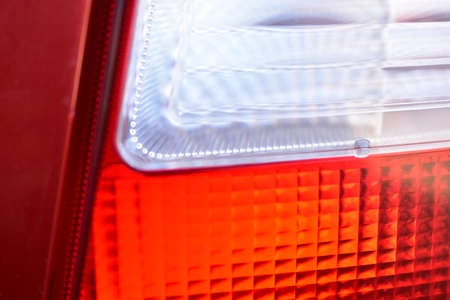 Rear red and white car glass lights close up
