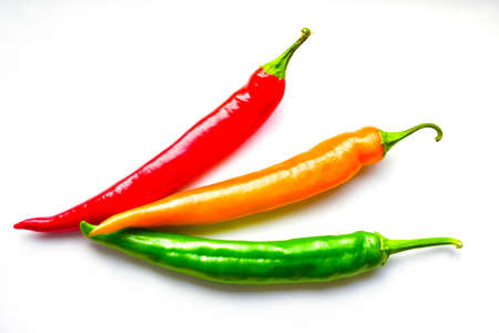 Regular and capsicum yellow and green pepper on a white background Imagens